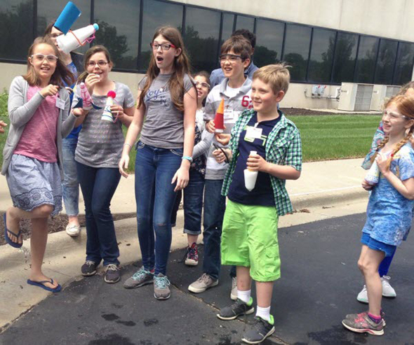Students react to the launch an Alka-Seltzer rocket