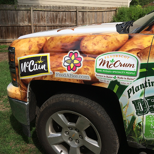 Sponsors cover the Feed a Bee pickup truck