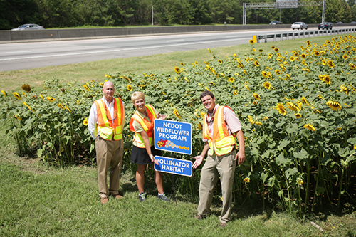 NC DOT with their roadside garden on the side of I-85