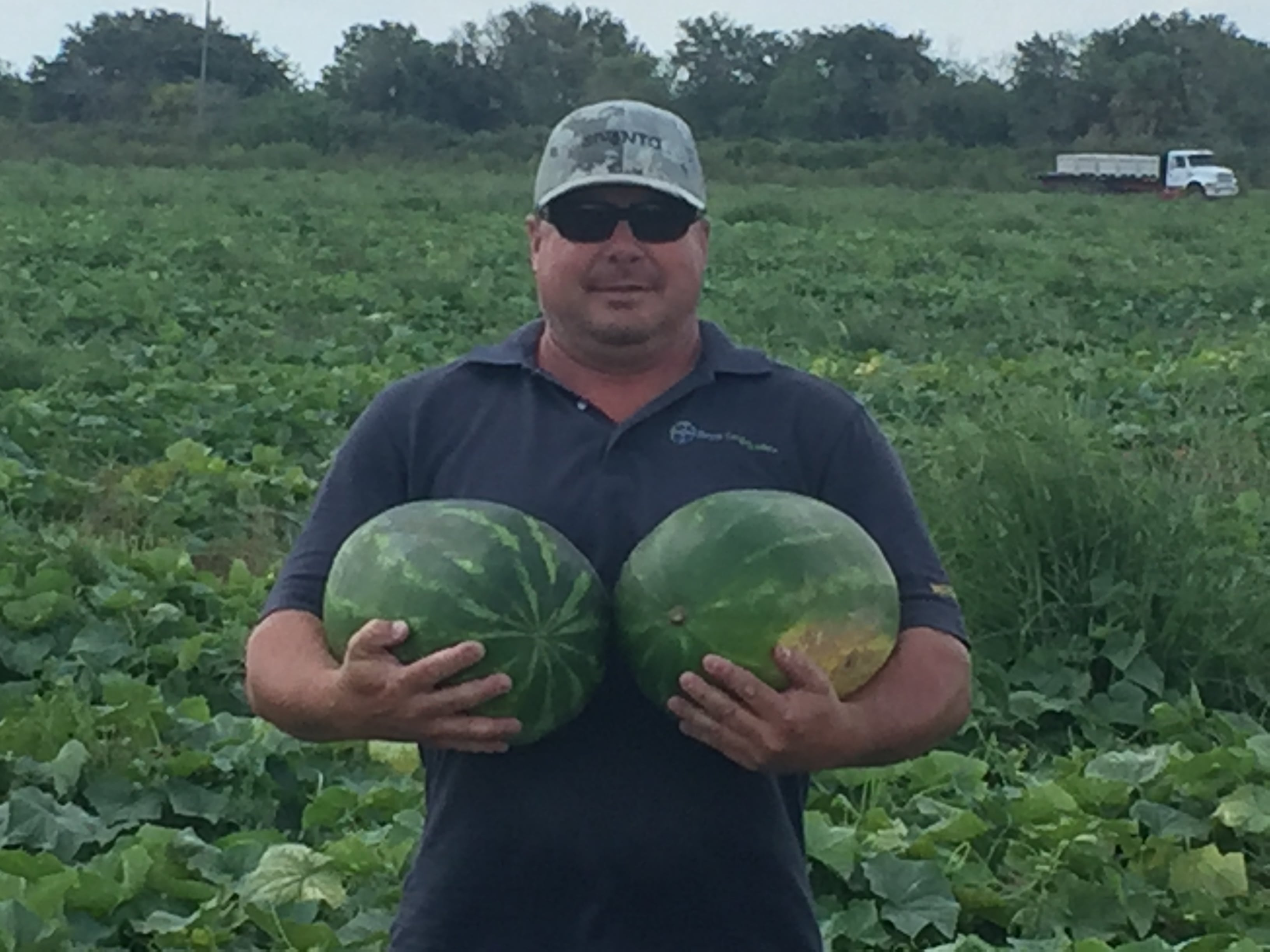 Stacey Howell holding watermelons