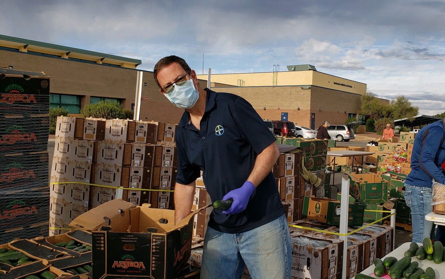 Brett Sowers, Bayer Marana employee, packing boxes of produce