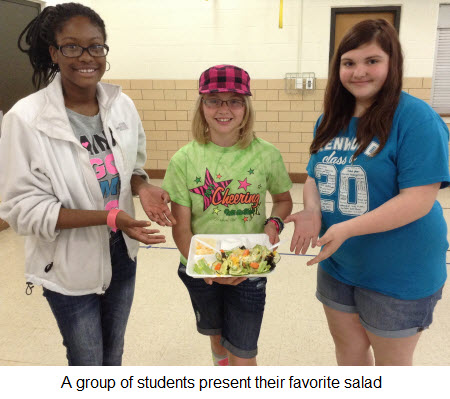 A group of students present their favorite salad