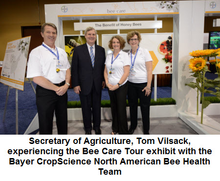 Secretary of Agriculture, Tom Vilsack, experiencing the Bee Care Tour exhibit with the Bayer CropScience North American Bee Health Team