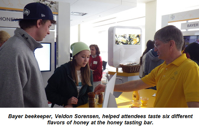 Bayer beekeeper, Veldon Sorensen, helped attendees taste six different flavors of honey at the honey tasting bar.
